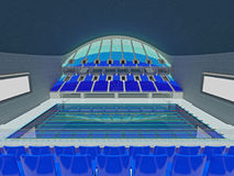 Indoor Olympic swimming pool arena with blue seats Stock Photos