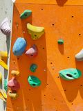 Indoor and outdoor sports climbing stone wall stock photography