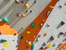 Indoor and outdoor sports climbing stone wall stock image