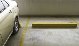 Indoor parking car. Empty parking car with yellow line deviding car Stock Images
