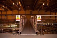 Indoor parts of small particle accelerator with radiation signs Royalty Free Stock Photography