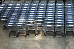 Many row of empty shopping carts waiting for customers. Indoor perspective view of many row of empty shopping carts waiting for customers Royalty Free Stock Photo
