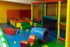 Indoor playground. Indoor children playground with inflatable arena and soft toys Royalty Free Stock Photo