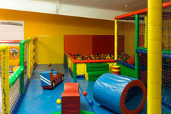 Indoor playground. Indoor children playground with inflatable arena and soft toys Stock Image