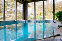 Indoor Pool. Photo of a newly installed indoor pool. Surface blank and mirrors the outside environment Stock Photo
