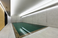 Indoor pool. Modern concrete house , indoor pool with sauna Royalty Free Stock Photography