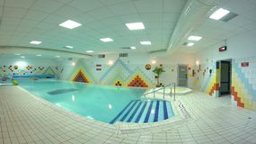 Indoor pool. With colorful tiling on walls Royalty Free Stock Photos