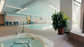 Indoor pool and jacuzzi in the partment building. Dolly shot stock video