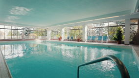Indoor pool in the partment building. Dolly shot stock footage