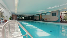 Indoor pool in the partment building. Dolly shot stock video