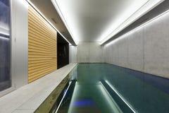 Indoor pool with sauna. Modern concrete house , indoor pool with sauna Stock Photo