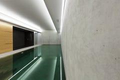 Indoor pool with sauna. Modern concrete house , indoor pool with sauna Stock Photography