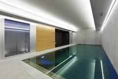 Indoor pool with sauna. Modern concrete house , indoor pool with sauna Stock Photos