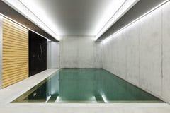 Indoor pool with sauna. Modern concrete house , indoor pool with sauna Royalty Free Stock Photo