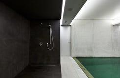 Indoor pool with sauna shower. Modern concrete house , indoor pool with shower Royalty Free Stock Photography