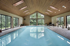 Indoor pool with skylights. Indoor pool in luxury home with skylights Stock Photos