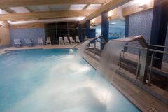 Indoor pool with waterfalls Stock Images