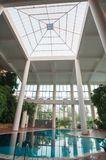 Indoor pool with white columns and foliage stock photography