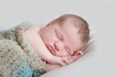 Indoor portrait of adorable newborn baby Royalty Free Stock Images