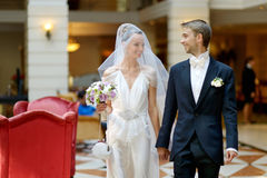 Indoor portrait of a beautiful bride and groom Royalty Free Stock Photography