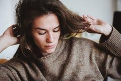 Indoor portrait of beautiful feminine thoughtful young women alone Stock Photos