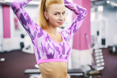 Indoor portrait beautiful sexy girl in sportswear in gym Stock Photos