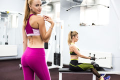 Indoor portrait beautiful sexy girl in sportswear in gym Stock Photo