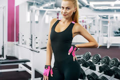 Indoor portrait beautiful sexy girl in sportswear in gym Royalty Free Stock Images