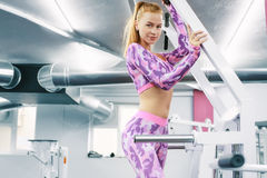 Indoor portrait beautiful sexy girl in sportswear in gym Royalty Free Stock Photos