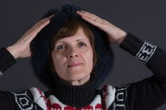 Caucasian senior woman in winter garments being happy Stock Photography