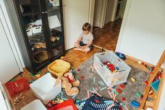Portrait of a child playing in a very messy room stock images