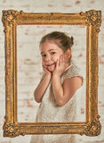Indoor portrait of an expressve adorable young little girl Stock Photos