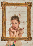Indoor portrait of an expressve adorable young little girl Stock Photo