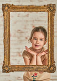 Indoor portrait of an expressve adorable young little girl Stock Photography