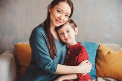 Indoor portrait of happy loving mother comforting toddler son at home. Casual lifestyles of modern family royalty free stock photos