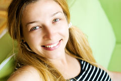 Indoor portrait of happy young woman royalty free stock photo