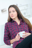 Indoor portrait smiling caucasian woman drinking tea Royalty Free Stock Photos