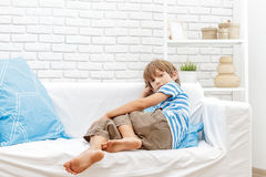 Indoor portrait of young boy watching tv. Indoor portrait of young child boy at home Royalty Free Stock Photo