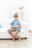 Indoor portrait of young boy watching tv. Indoor portrait of young child boy at home Stock Photo