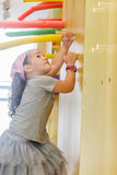 Indoor portrait of young happy child girl. Outdoor portrait of young happy child girl having fun on playground Stock Images
