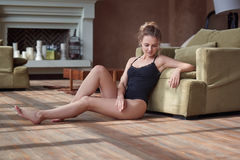 Indoor portrait of young sexy woman in a bodysuite Royalty Free Stock Photography