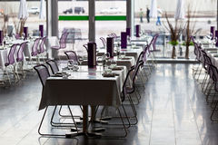 Indoor restaurant tables ready for service Royalty Free Stock Photography