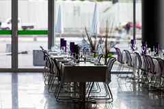Indoor restaurant tables ready for service Royalty Free Stock Photos