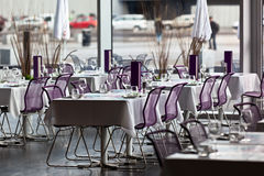 Indoor restaurant tables ready for service Royalty Free Stock Photo