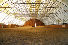 Indoor riding arena covering sand for trainings Stock Photos