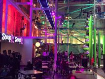 Indoor ropes course in New Haven. Indoor ropes course at Jordon's Furniture New Haven , Connecticut, with coffee area and purple red and green lights and Royalty Free Stock Photo