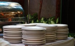 Indoor settings of a wedding event. With plates stack up Royalty Free Stock Image