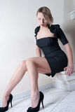 Indoor shoot of a model in a black dress royalty free stock images