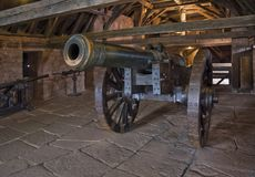 Cannon in Haut-Koenigsbourg Castle. Indoor shot of Haut-Koenigsbourg Castle in France with historic cannon Royalty Free Stock Photos
