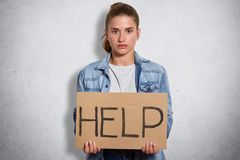 Indoor shot of upset victim being raised in patriarchal world asking for help in like minded people, searching for support and. Understanding, hoping for unity stock photography